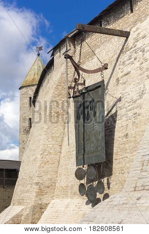 View on ancient fortress wall with symbolic shield and sword, Pskov, Russia