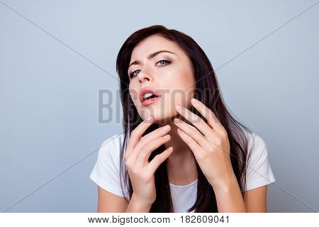 Close Up Photo Of Young Girl Squeezing Out A Pimple On Her Chin