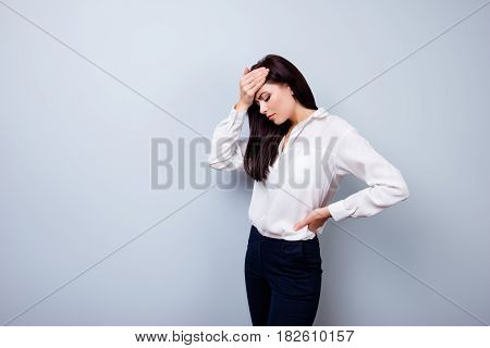 Young Sad Female Worker Touching Her Forehead Because Of Having Headache After Long Working Day