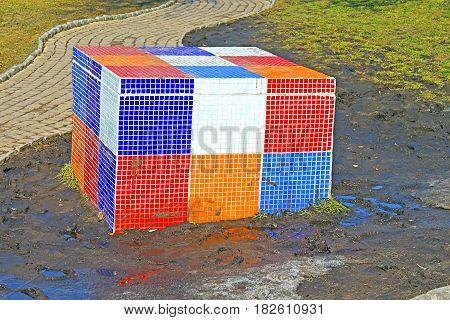 KYIV, UKRAINE - MARCH 18, 2012: Rubik Cube on the children's Alice in Wonderland playground in Picturesque Alley by sculptor Konstantin Skretutskiy