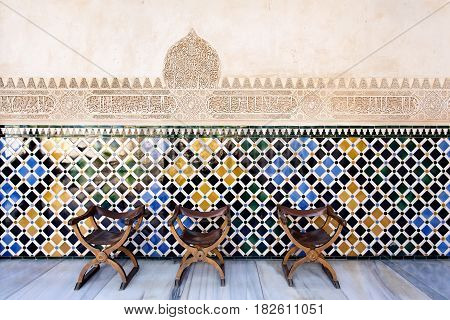 Vintage Traditional Chairs In The Court Of The Myrtles, Alhambra Palace, Granada, Spain
