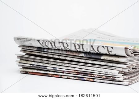 Close up of a stack of folded newspapers The Wall Street Journal and Chicago Tribune(for editorial use only)