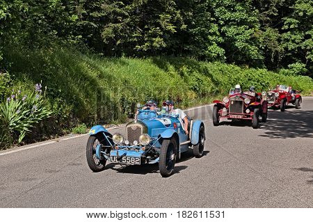 PASSO DELLA FUTA (FI), ITALY - MAY 21: driver and co-driver on a vintage Franch car Rally ABC (1929) in classic car race Mille Miglia, on May 21, 2016 in Passo della Futa (FI) Italy
