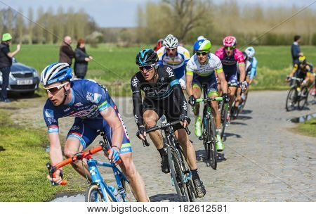 Hornaing France - April 102016: The Italian cyclist Salvatore Puccio of Team Sky riding in the peloton on a paved road in Hornaing France during Paris Roubaix on 10 April 2016.