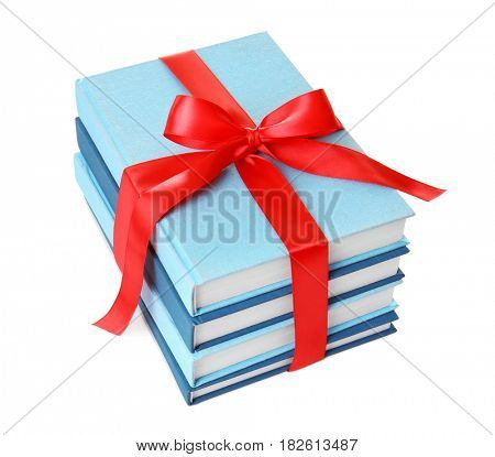 Stack of books with ribbon as gift on white background