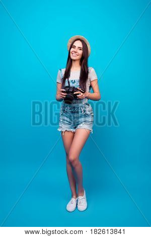 Full-lengh Portrait Of Cheerful Young Woman Using Camera For Taking Photos