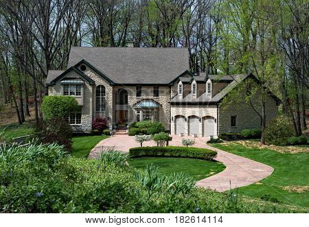 Grand Stone House Down in Wooded Setting