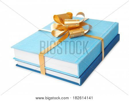 Two books with ribbon as gift on white background
