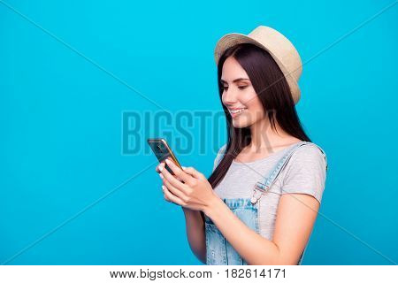 Side View Portrait Of Pretty Young Woman In Summer Hat Sending Sms To Her Best Friend