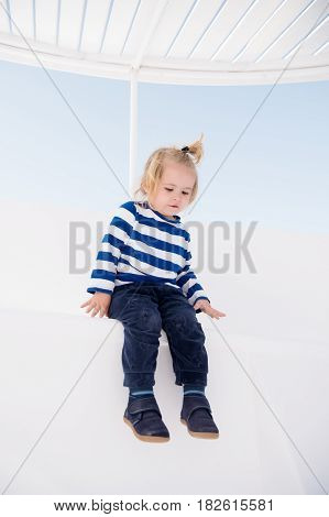 Fashionable Small Baby Boy On Boat In Marine Shirt, Pants