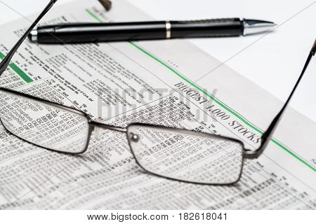 Glasses and a pen on a stock section of The Wall Street Journal(for editorial use only)