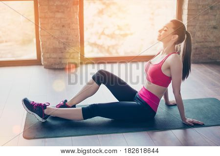 Well Done! Satisfied Young Girl Sitting And Relaxing After Her Work Out. She Is Totally Peaceful, Br