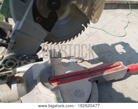 Mitre saw woodworking power tools closeup with circular saw