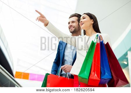 It's Shopping And Fun  Time. Cheerful  Successful Cute Happy Young Lovely Couple In Jacket Holding