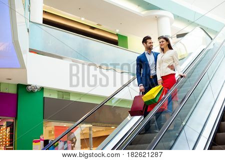 Concept Of Consumerism, Sale And People. Stylish Beautiful Happy Young Lovely Couple With Colored Sh