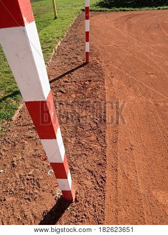 Detail Of Gate Frame . Outdoor Football Or Handball Playground, Light Red Clay. Red Crushed Bricks S