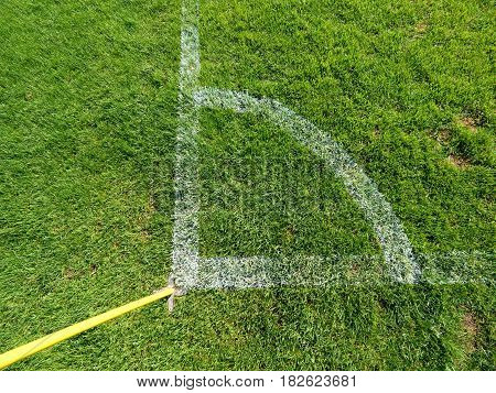 Football Field Corner Detail With White Marks And Flag Stick