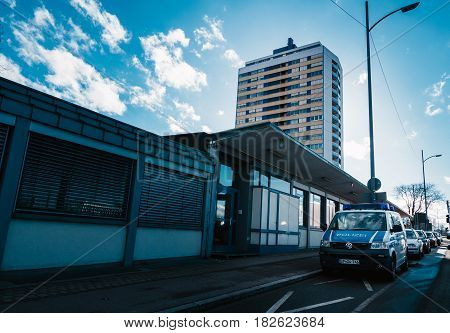 KEHL GERMANY - FEB 3 2017: German police station with Volkswagen police van parked in front and large German architecture apartment building in the background