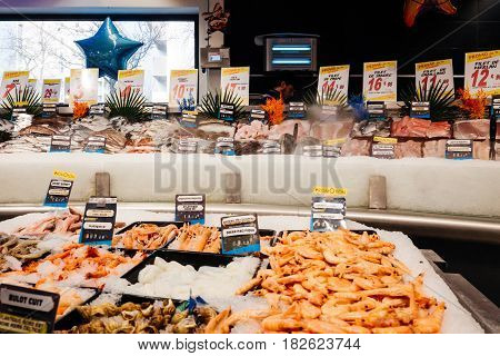 PARIS FRANCE - FEB 4 2017: Supermarket counter stall with raw fish - fresh fish counter full with diverse - organic fish meat