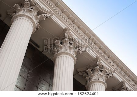 Beautiful columns of the capital on the facade of the historic building.
