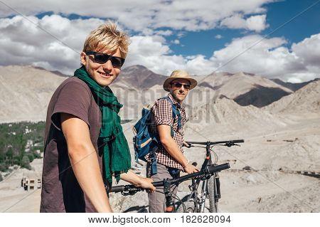 Two happy smiling mountain bikers in Himalaya mountain