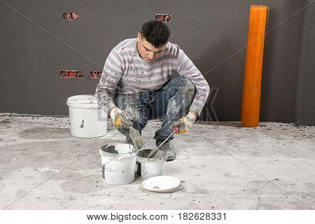 Painter mixing paints