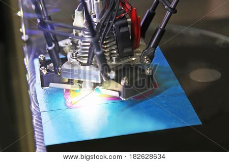 Modern 3D printer printing figure close-up macro.Automatic three dimensional 3d printer performs plastic three-dimensional model.