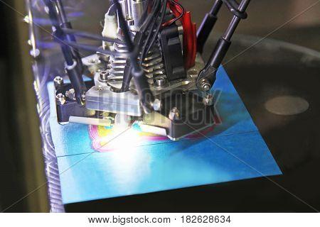 Modern 3D printer printing figure close-up macro.Automatic three dimensional 3d printer performs plastic three-dimensional model.