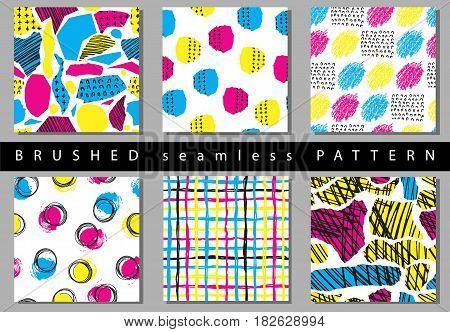 Vector Set of seamless pattern with brush stripes and strokes. Yellow pink blue color on background. Hand painted grange texture. Ink geometric elements. Fashion modern style. Endless fabric print