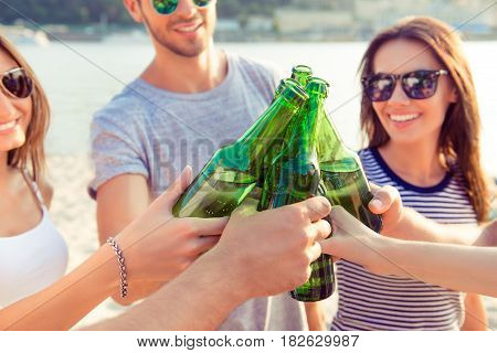 Concept Of Celebration And Friendship. Group Of Happy Smiling Young People In Sunglasses Clinking Bo