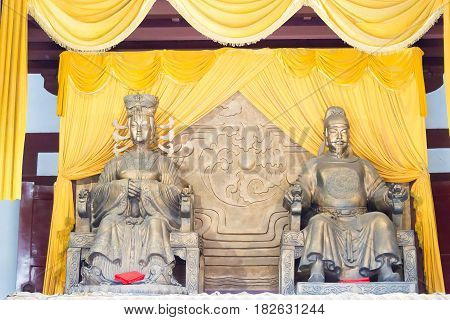Sichuan, China - Mar 29 2015: Statues Of Wu Zetian And Emperor Gaozong At Huangze Temple. A Famous H