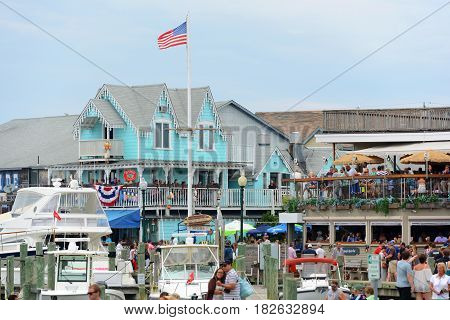 MARTHA'S VINEYARD, MA, USA - JULY. 3, 2015: Carpenter Gothic Cottages with Victorian style, gingerbread trim on Lake Avenue, Oak Bluffs on Martha's Vineyard, Massachusetts, USA. Lake Avenue is the commercial center of Oak Bluffs.