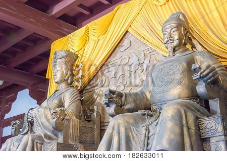 Sichuan, China - Mar 29 2015: Statues Of Empress Wu Zetian And Emperor Gaozong At Huangze Temple. A