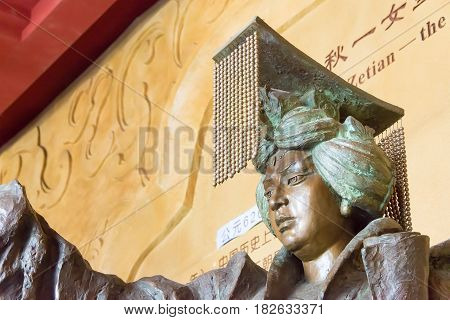Sichuan, China - Mar 29 2015: Statue Of Empress Wu Zetian At Huangze Temple. A Famous Historic Site