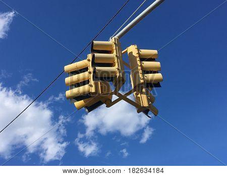 traffic light hanging against sky. semaphore. street.