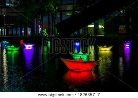 BERLIN - OCTOBER 08 2016: Festival of lights. Installation of luminous ships on the water. Potsdamer Platz.