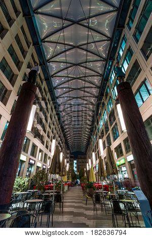 BERLIN - OCTOBER 08 2016: Heiligegeistkirchplatz - narrow street and covered shopping area in the center of Berlin.