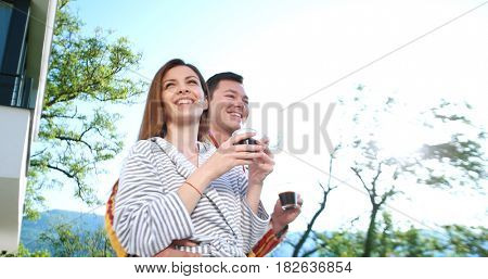 Couple Enjoy Drinking Coffee On Terrace In The Morning