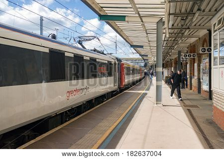 Ipswich, UK. 17th April 2017. A Greater Anglia express service is about to depart for London. Some people remain on the platform awaiting a connecting train.
