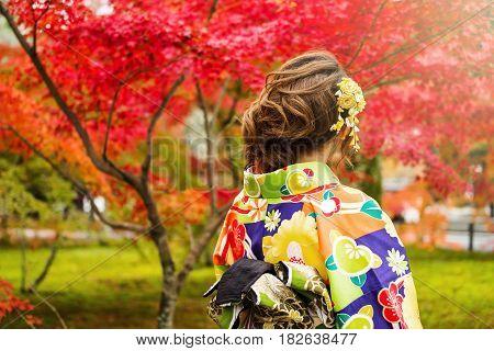 Japanese Girl In Kimono At Autumn Garden