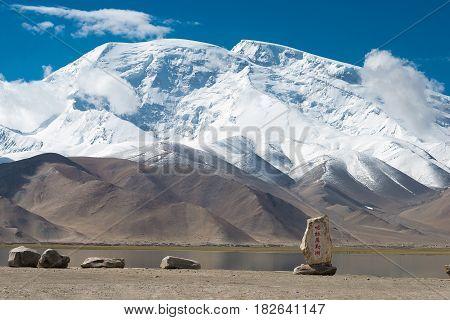 Xinjiang, China - May 21 2015: Karakul Lake Monument At Karakul Lake. A Famous Landscape On The Kara
