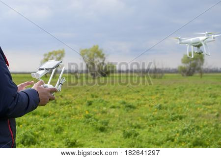A Man With A Remote Control In His Hands. Flight Control Of The Drone. Phantom