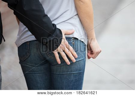 Close-up Of Man Touching Woman's Ass From Back