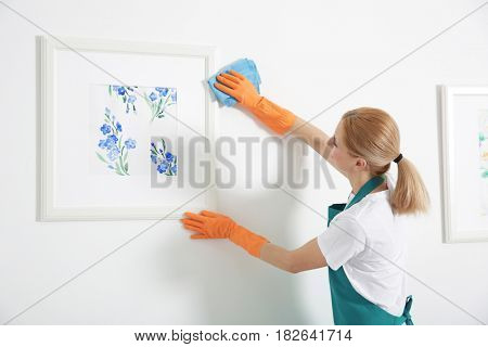Woman with rag cleaning home