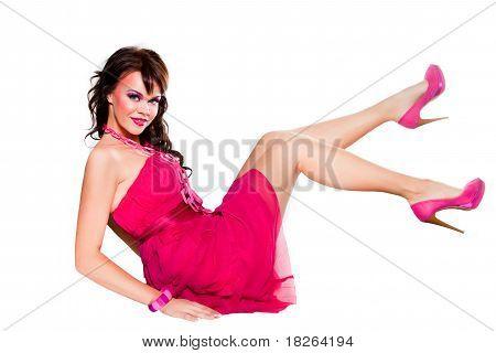 beautiful girlwearing pink sitting on white background