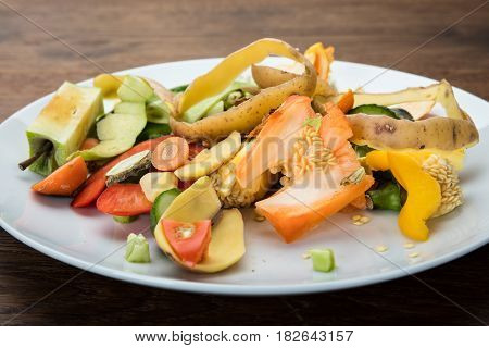 Waste Based Cooking. Vegetables And Fruit Peelings On White Plate