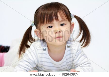 lying small Japanese girl (2 years old)