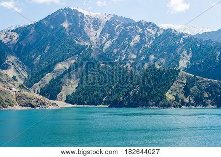 Xinjiang, China - May 09 2015: Heaven Lake Of Tian Shan(tianchi). A Famous World Heritage Site In Fu