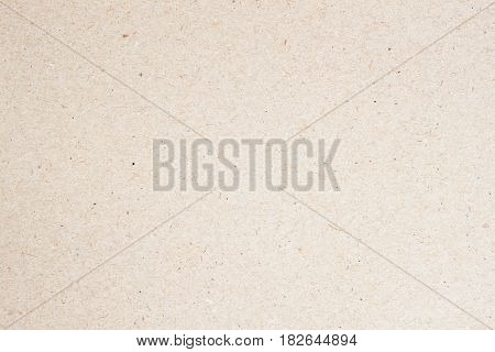 Organic cardboard texture close-up, natural rough textured paper background