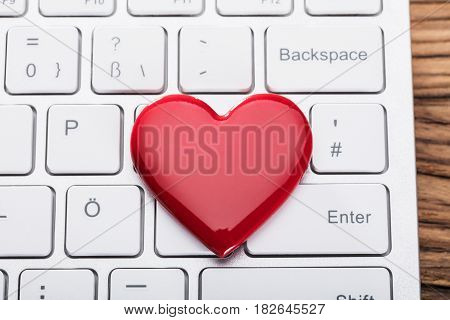 Elevated View Of Red Heart Shape On White Keyboard